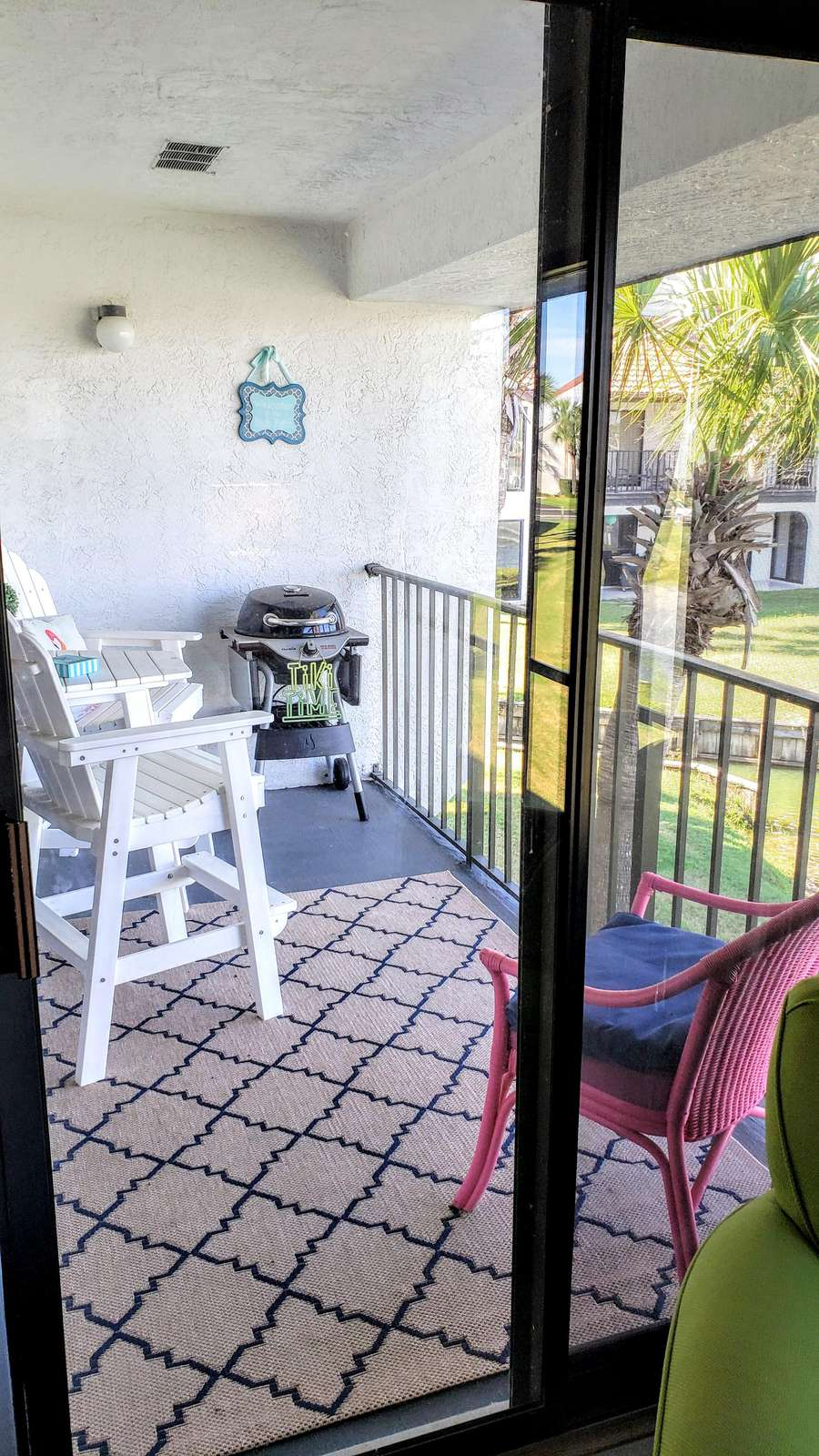 Cozy balcony with grill to relax to the sights and sounds of the fountain/lake
