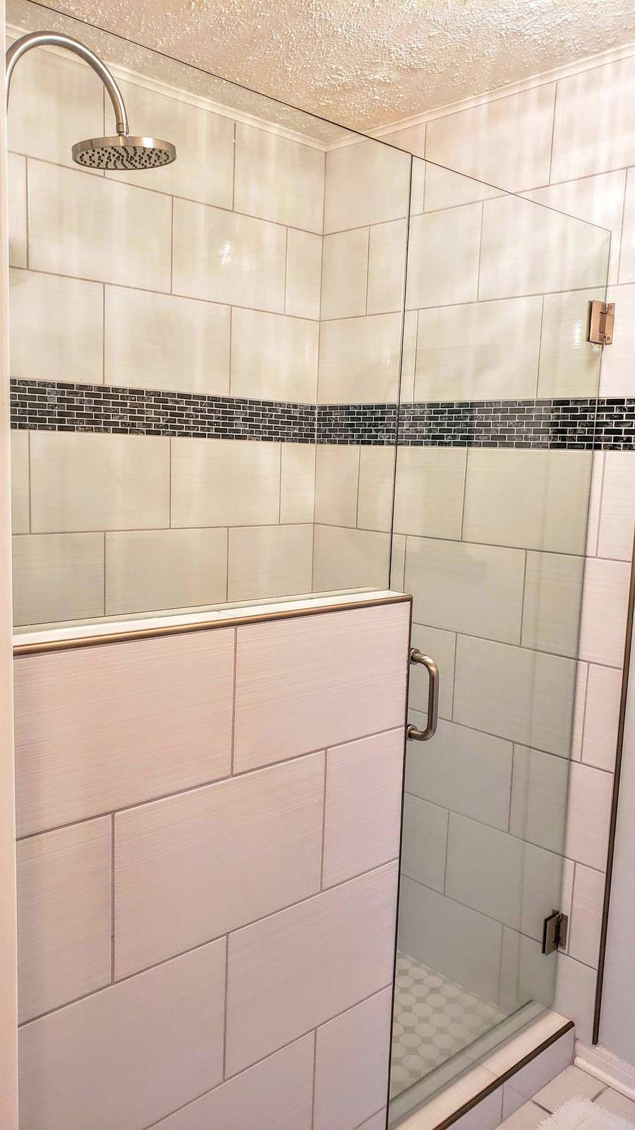Completely updated walk-in shower and fixtures