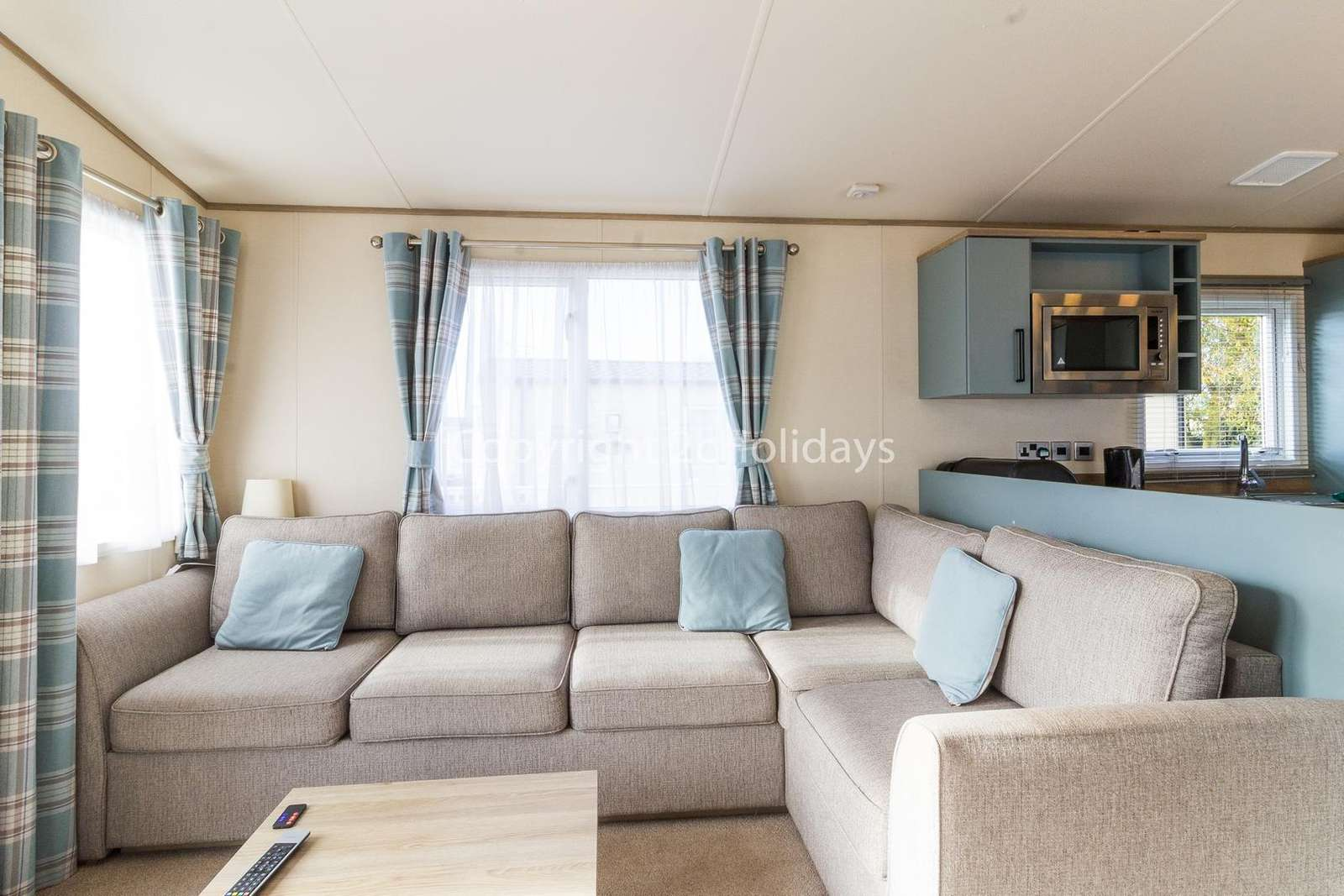 A very cosy and modern lounge comprising of a sofa bed and TV/DVD player