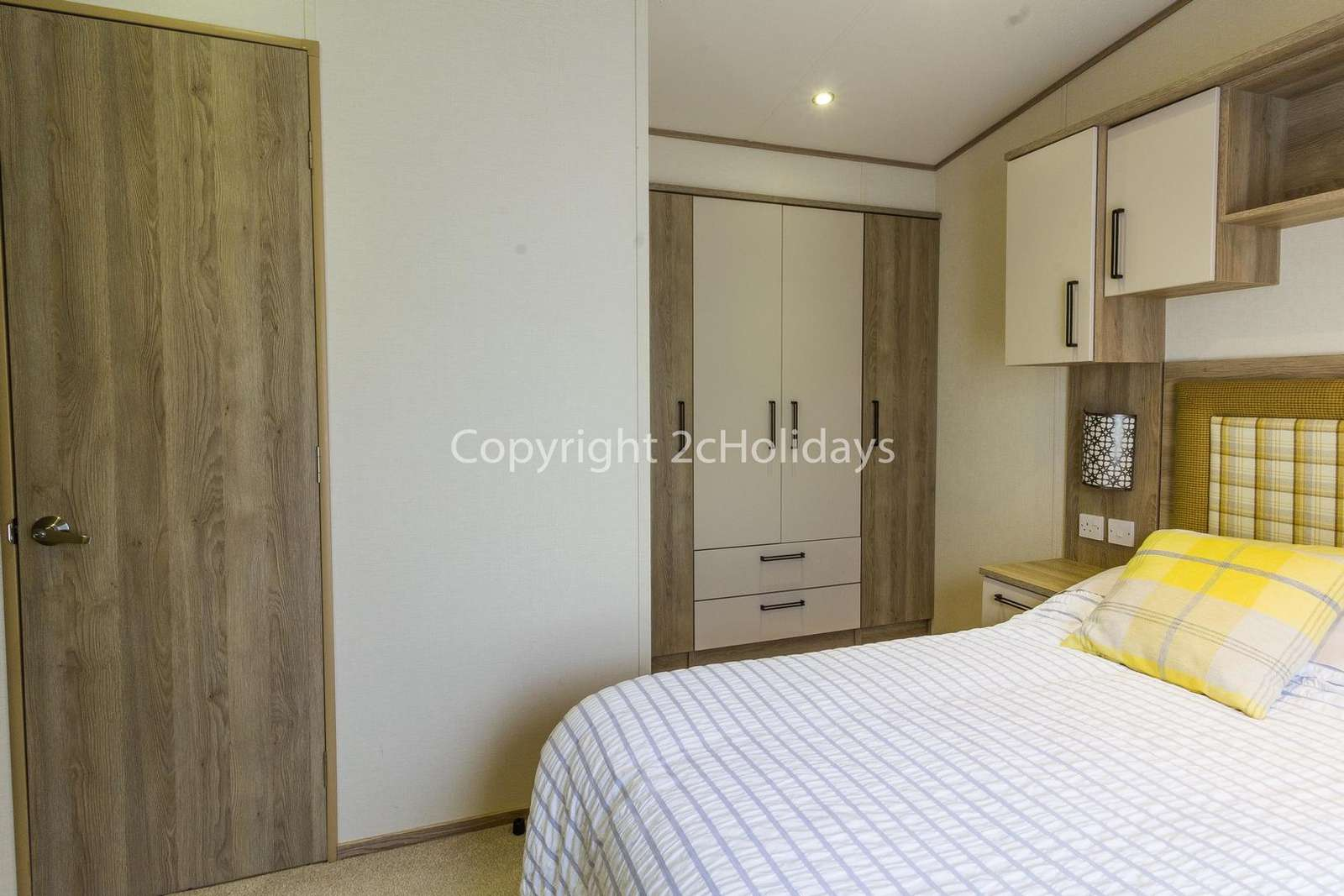 You can find plenty or storage in this master bedroom