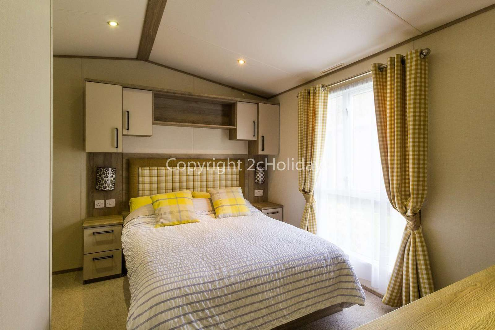 Spacious and modern master bedroom with a TV!