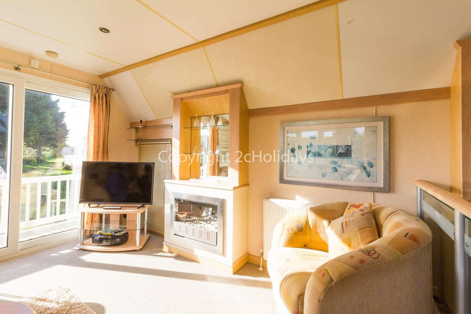 The living area is a great place to relax with a double sofa bed and TV