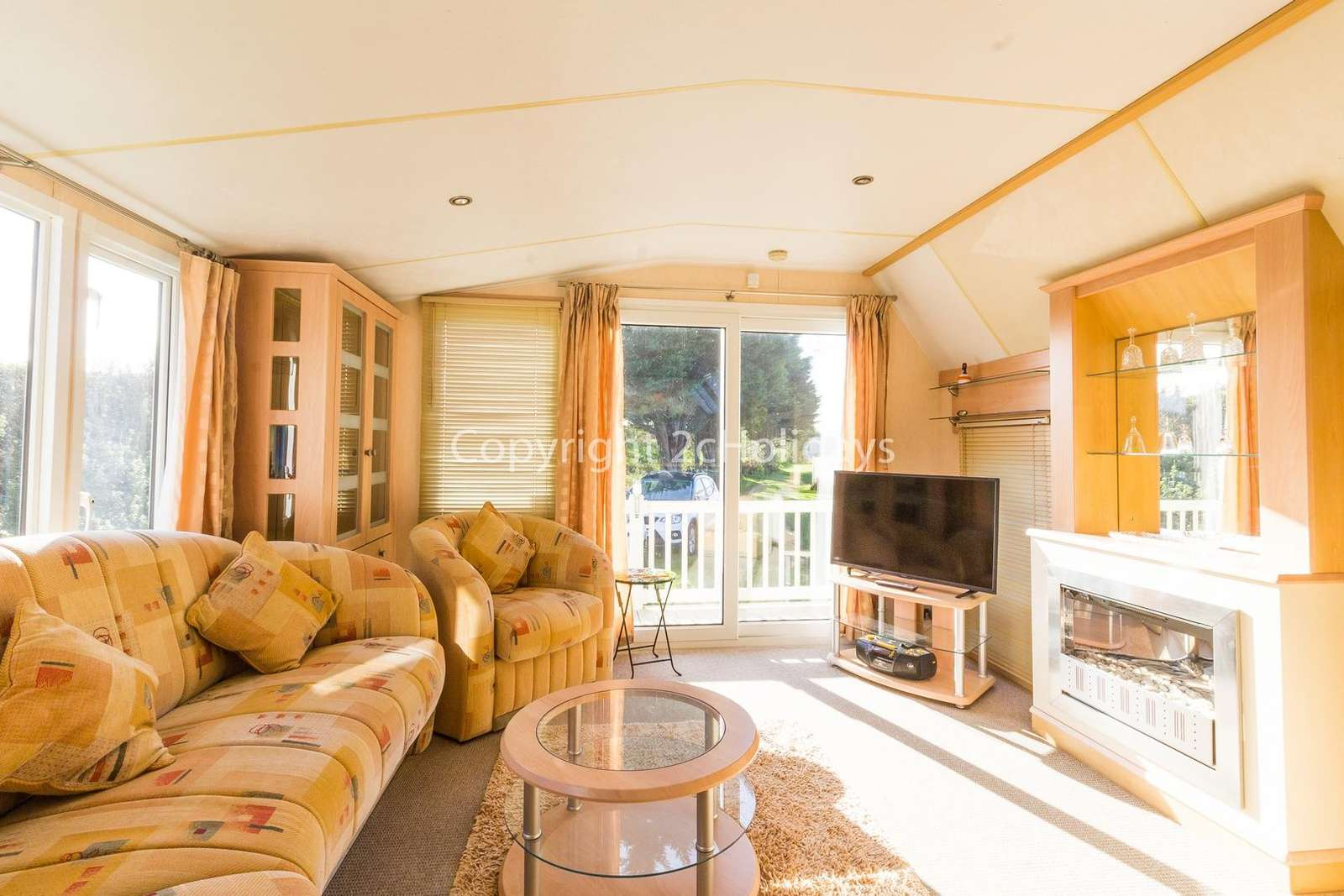 Beautiful sliding doors leading to the outside decking area, perfect for families!