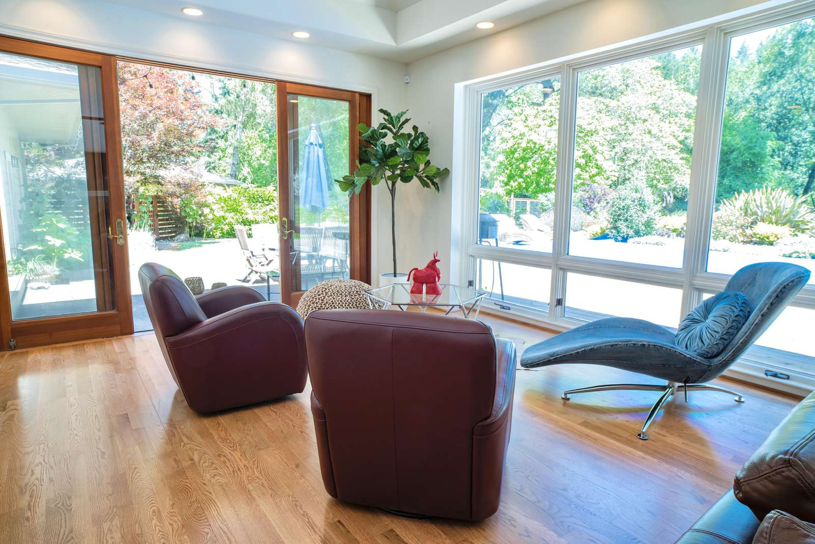 Conversation area of living room overlooking pool