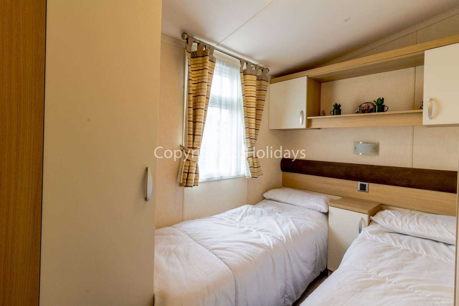 You can find lots of storage space in this twin bedroom