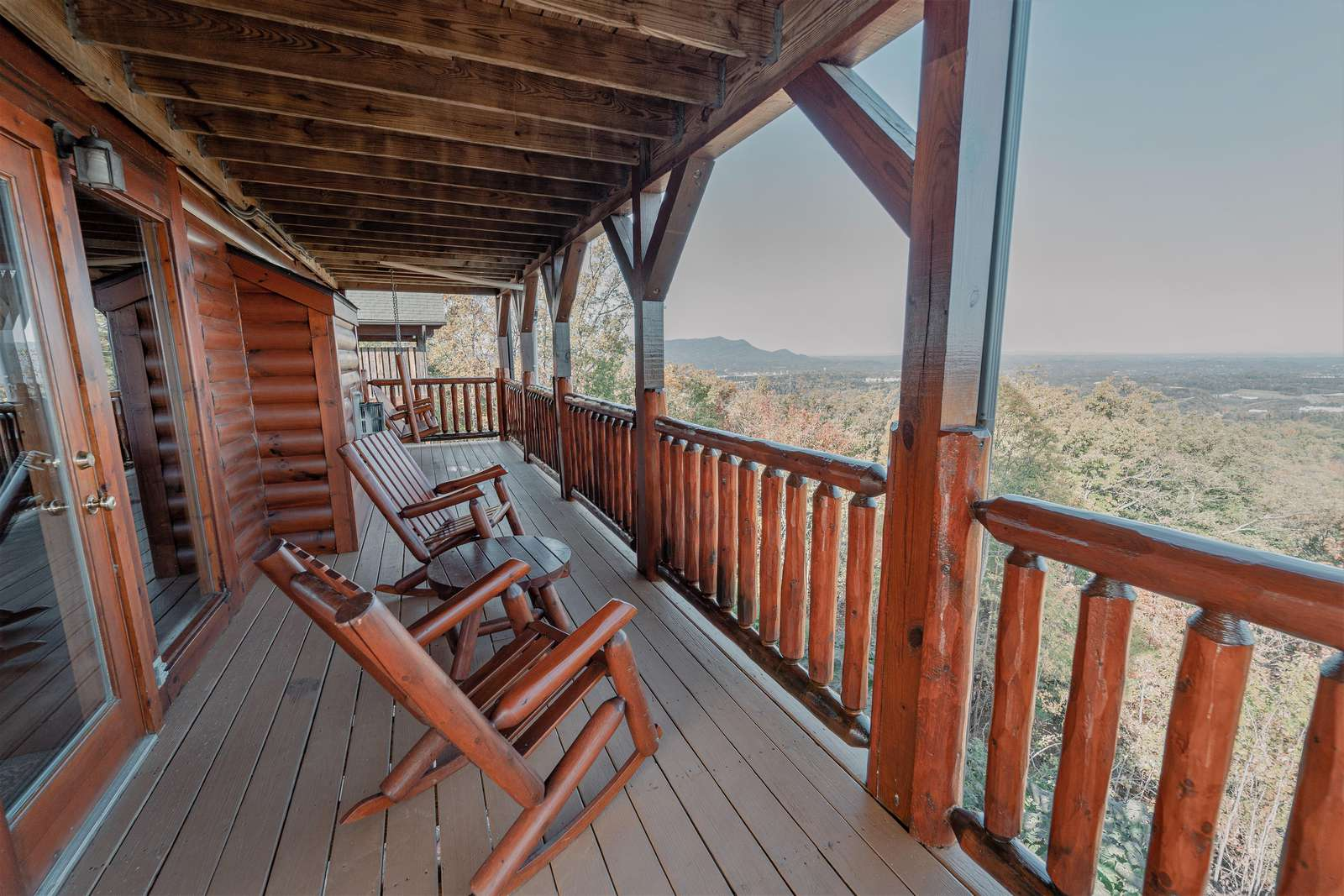 Main level balcony where you can relax with a cup of coffee in our aspen log rocking chairs