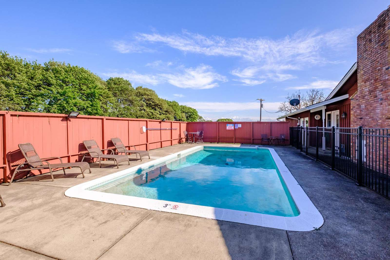 Pool with a surround safety gate.