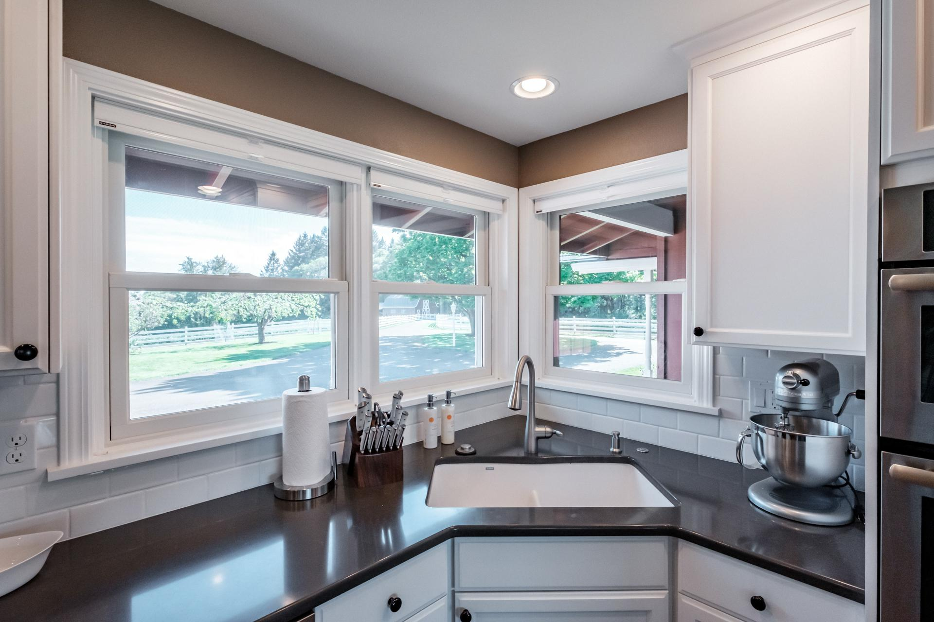 Kitchen sink - Great view of the barn and front of the property.