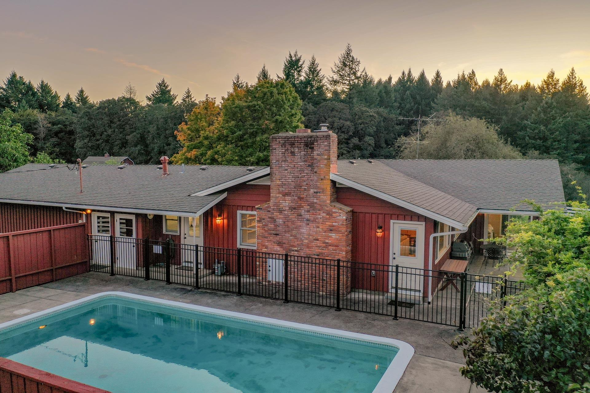 Highland Acres - The backyard has a swimming pool and pergola or entertaining.