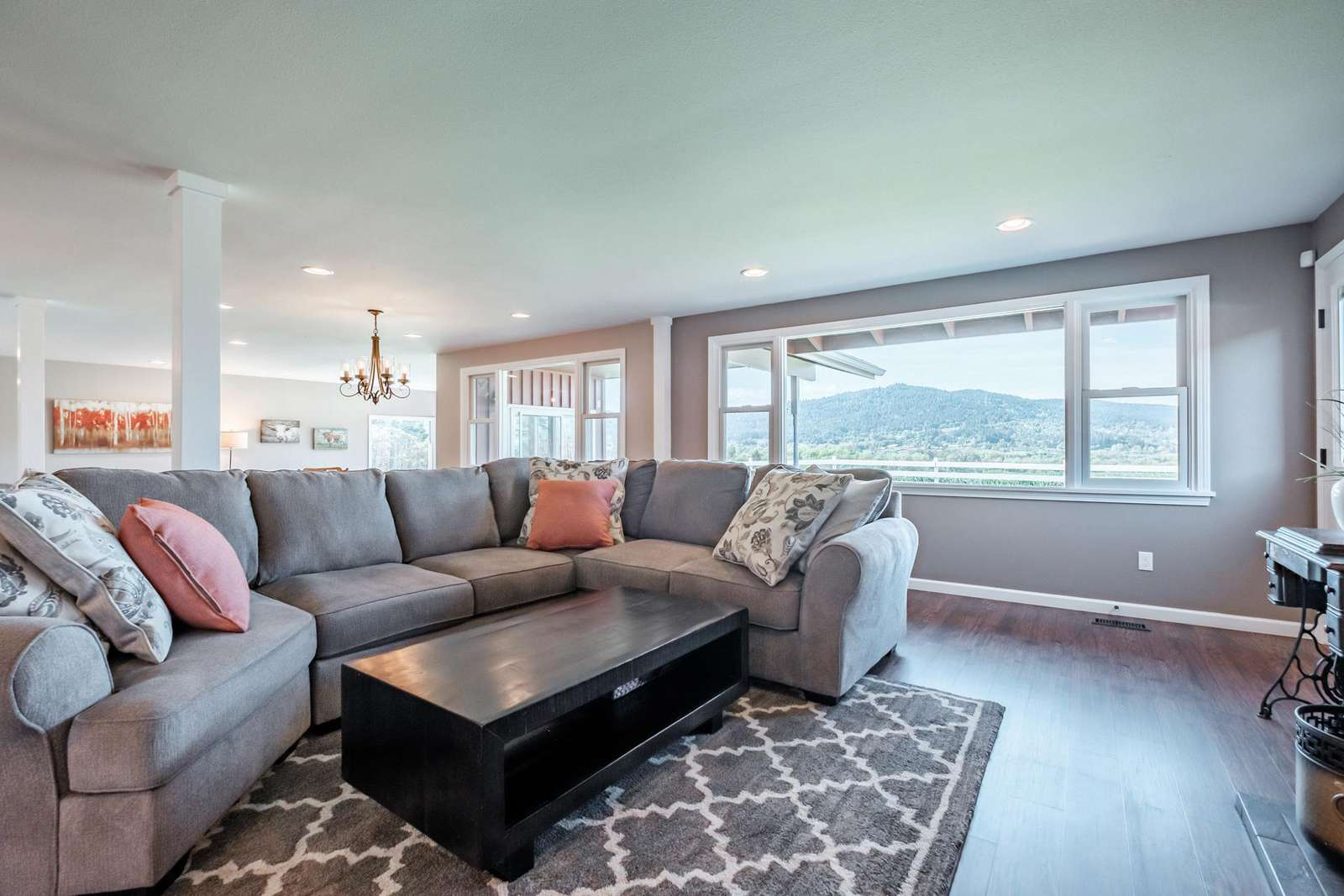 Separate sitting area with sectional couch, fireplace and  HDTV.