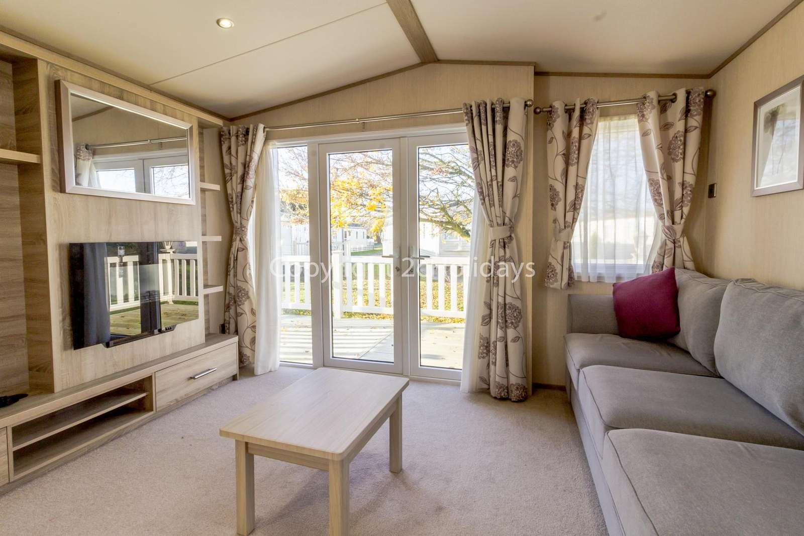 Stunning lounge with double doors leading to the decked area!