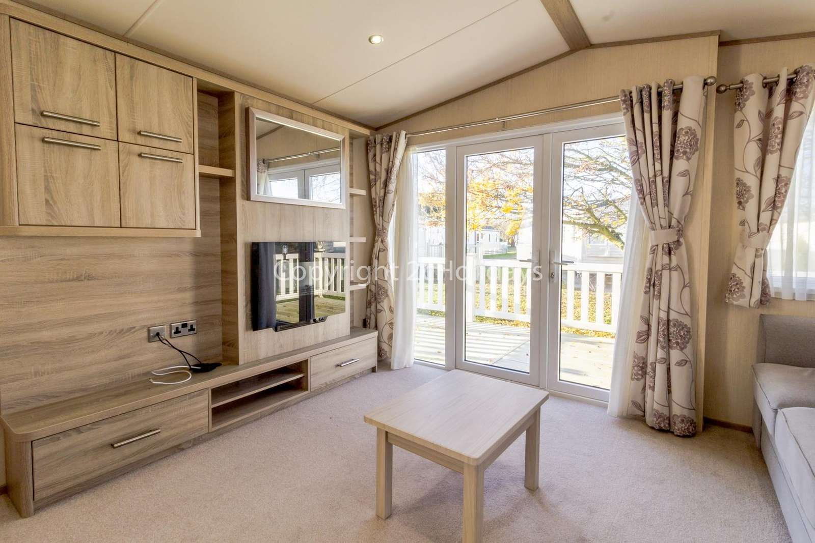 Homely lounge with a TV and electric fire!