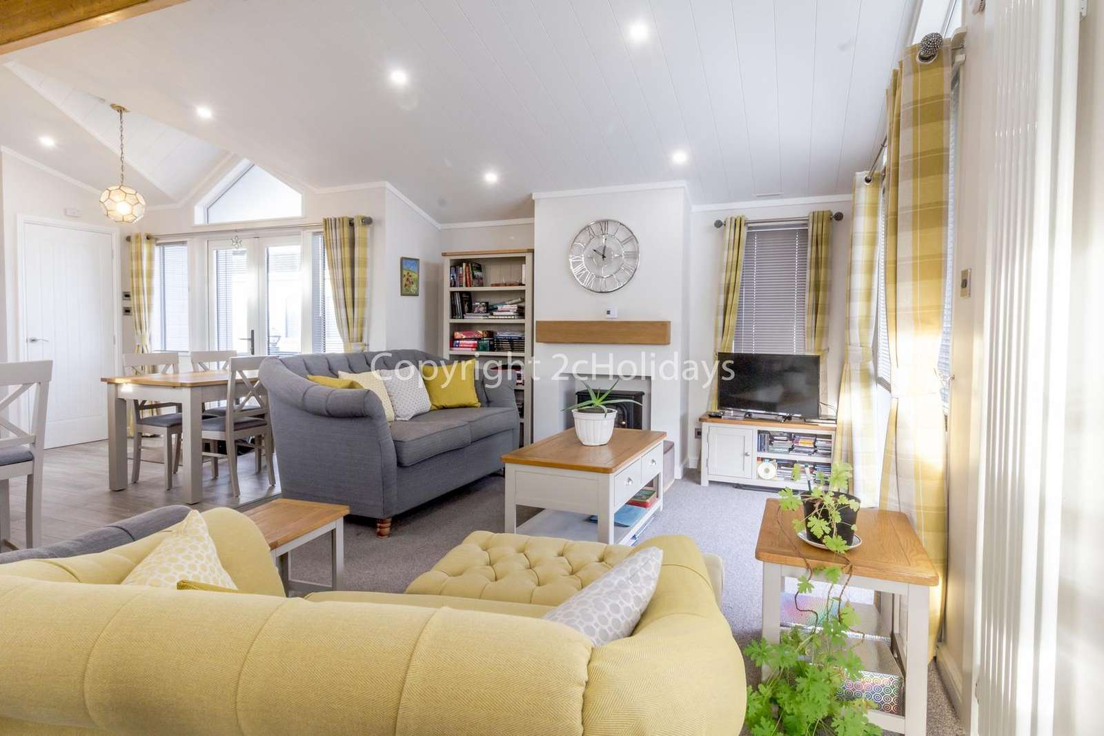 This living area includes a TV and a cosy electric fire!