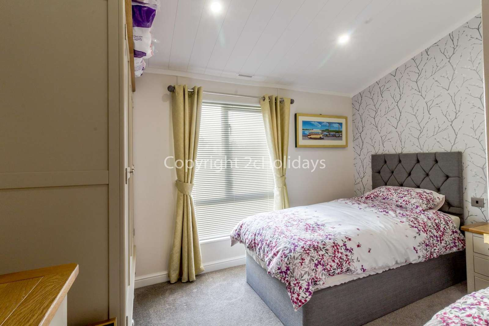 Spacious twin bedroom with space for a travel cot if needed