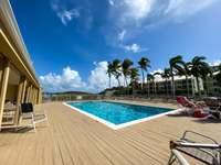 The shared pool for the condo community. Just steps away from the beach thumb
