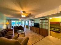 The spacious living room with comfortable furnishings thumb