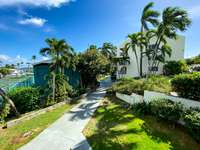 The Anchorage - nicely manicured lawn and greenery....with a path to the beach! thumb