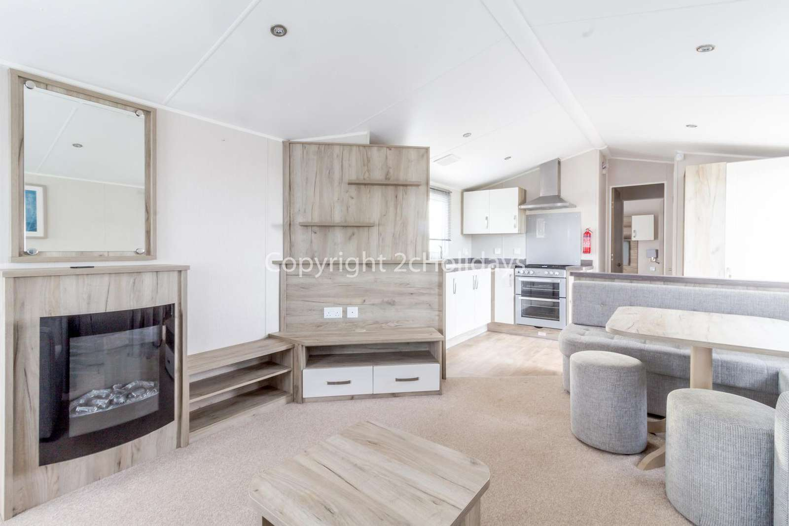 Beautifully designed living/dining area and a kitchen with a electric fire