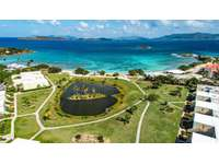 An aerial of Crystal Cove with Sapphire Beach, St. John, and the British Virgin Islands in the background! thumb