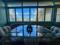 Screened-in Lanai with views of the pond and beach. thumb
