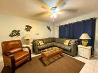 The plush, spacious living room, with large screen LED TV! thumb