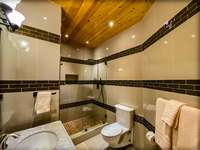 Bedroom 4's elegant and roomy ensuite bath! thumb