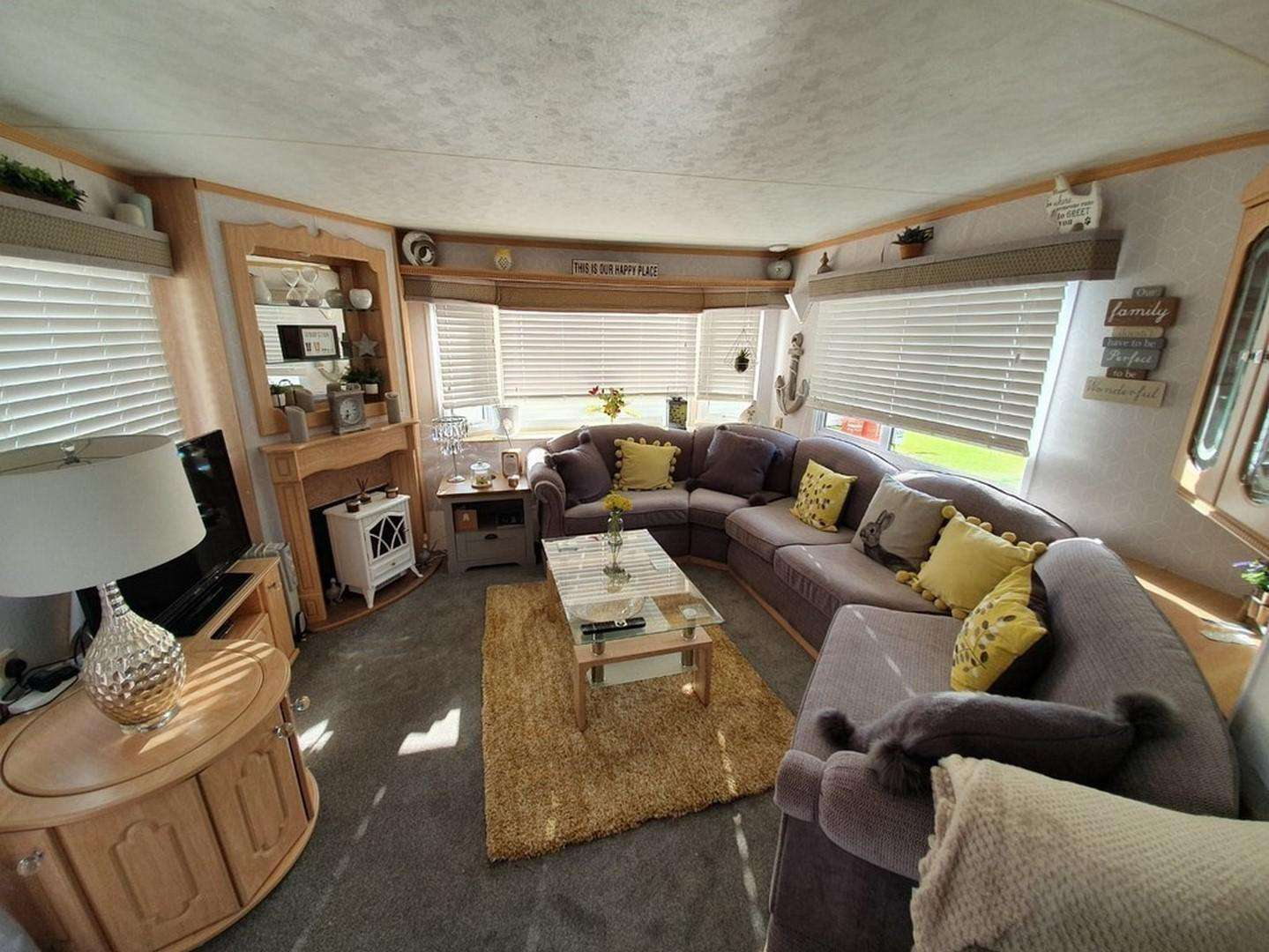 Such a cosy living area with a TV and sofa bed