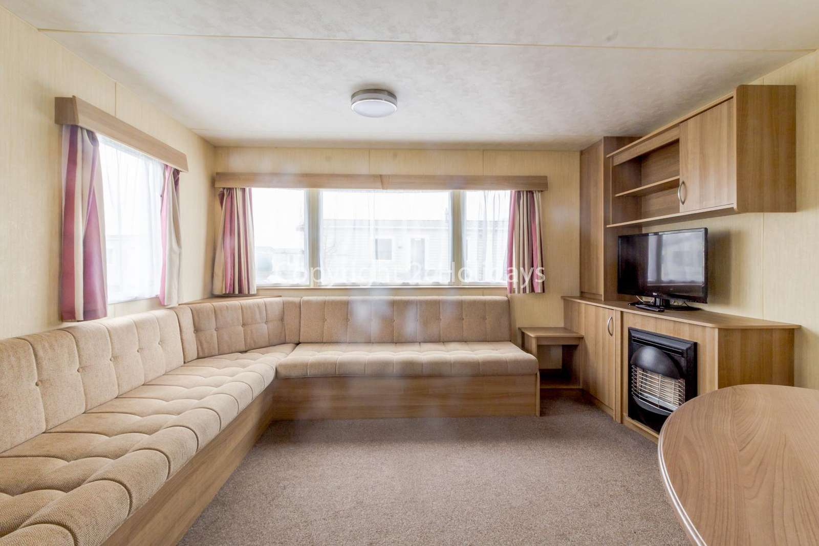 A cosy lounge with a TV and gas fire!