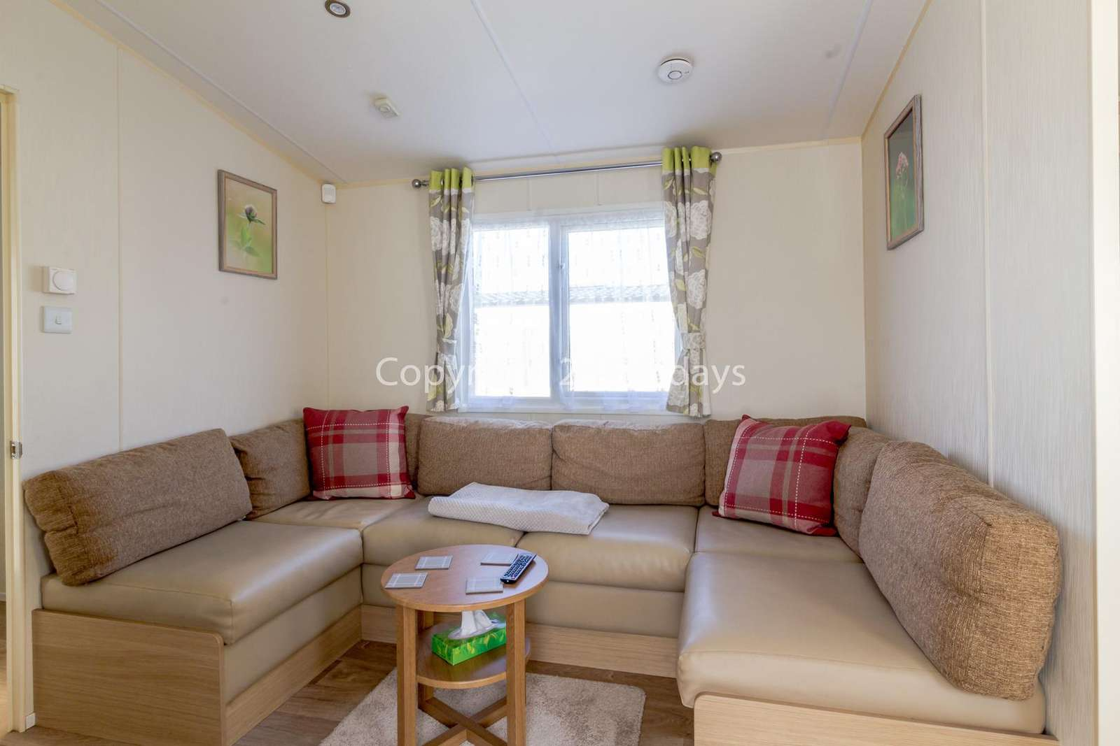 A cosy lounge area with a TV and a comfortable sofa bed