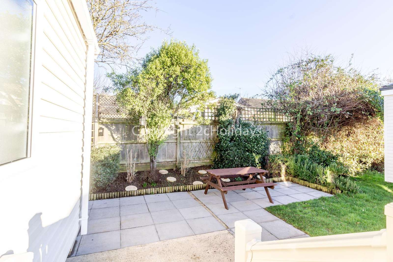 Lovely private patio area with outside furniture to relax in the sunshine