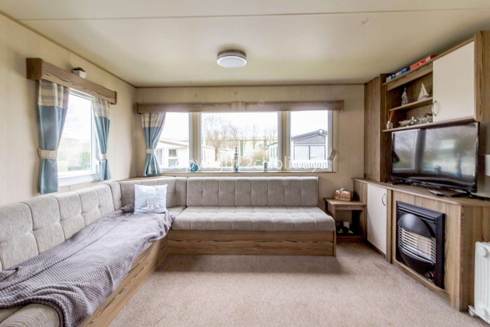 Spacious lounge with a TV and gas fire!