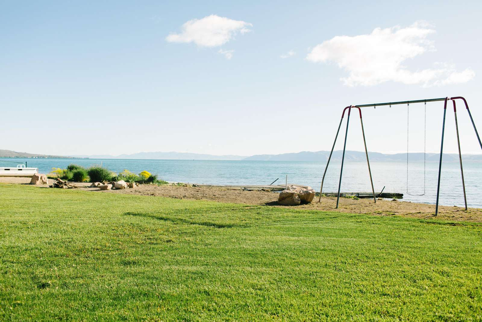 Large grass back yard and beach access