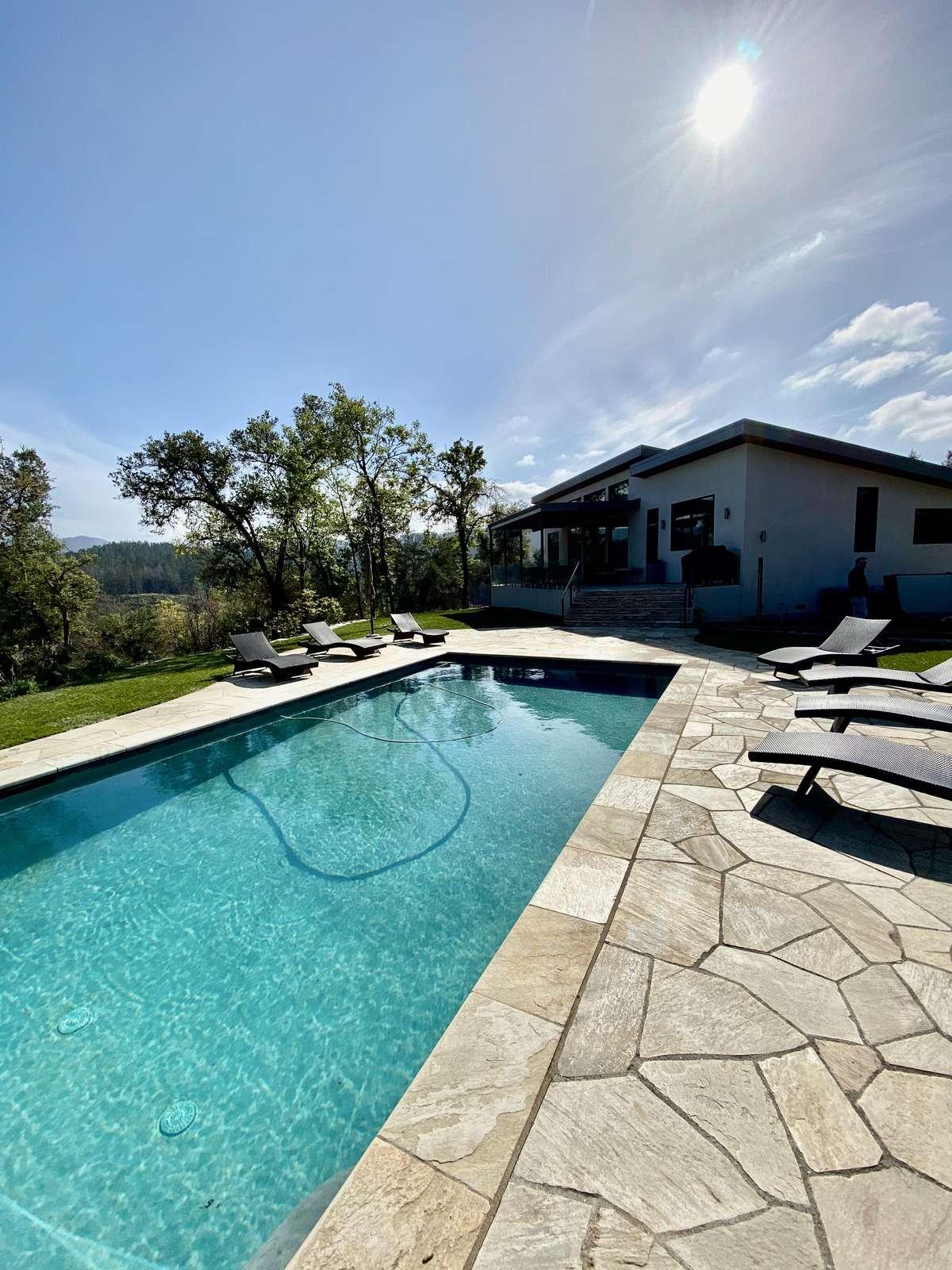 Large pool with views of vineyards beyond