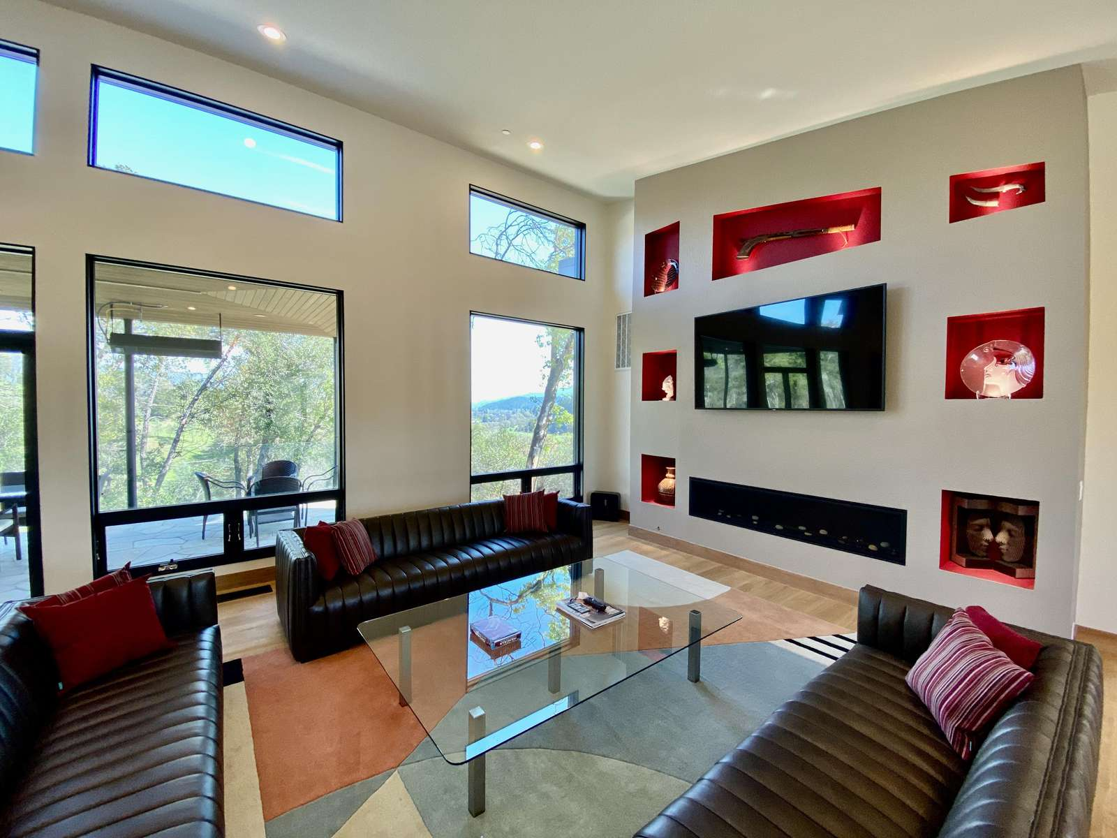 Large main living room with fireplace and vineyard views