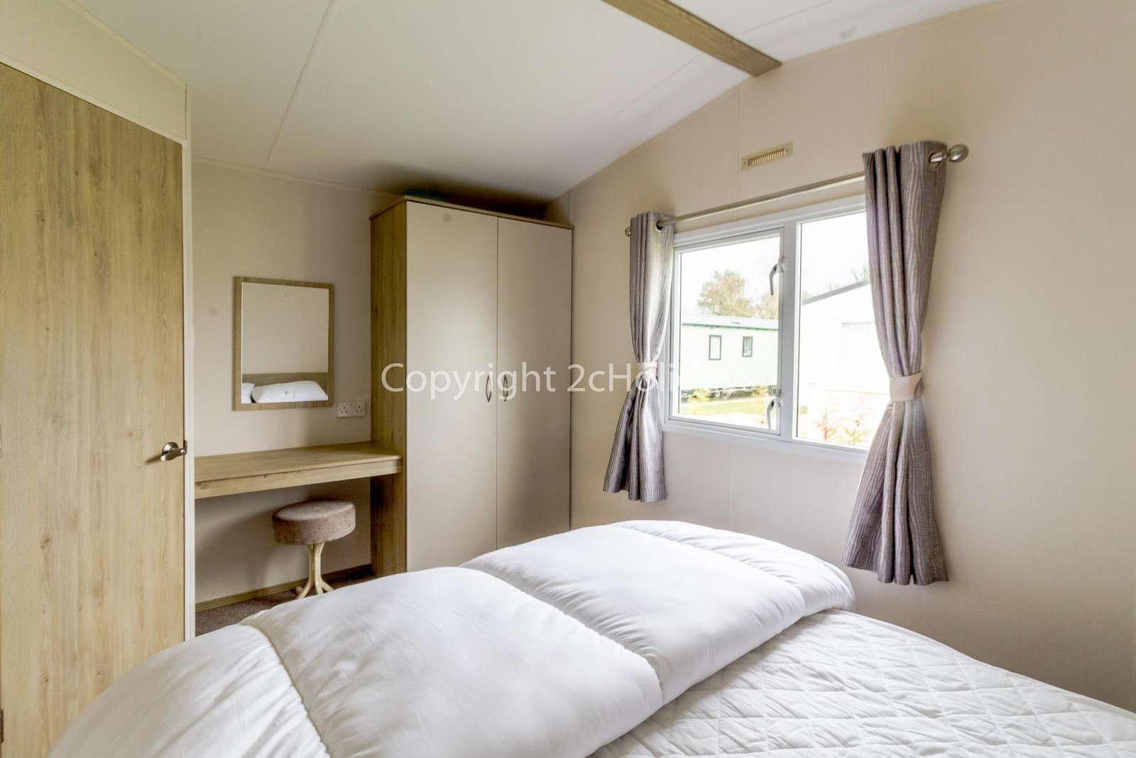 Great size master bedroom with a dressing table!