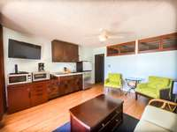 The spacious living room and kitchenette. thumb