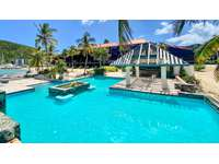 The Sapphire pool - right on the beach! thumb