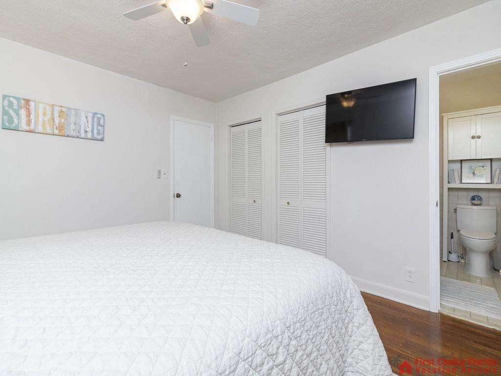 Deja Blue Bed with TV and Bathroom Door