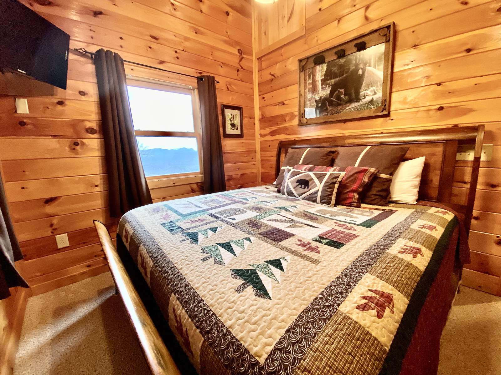 King Bedroom on the upper level offers a Private Deck and Flat Screen TV