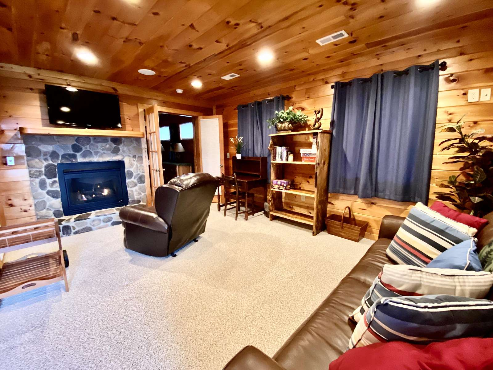 Master Bedroom Level includes a second Living Area with a Cozy Fireplace and Flatscreen TV