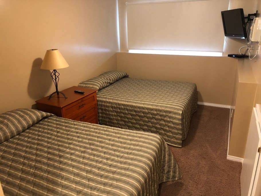 Lower level condo. Bedroom 2 with two queen beds and attached full bathroom.