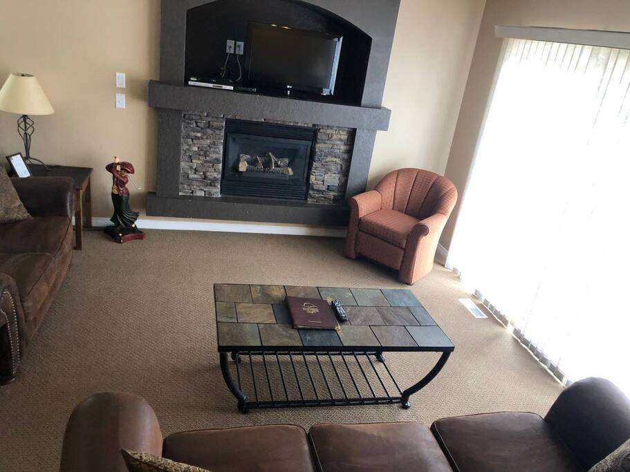 Upper level living room and electric fireplace.