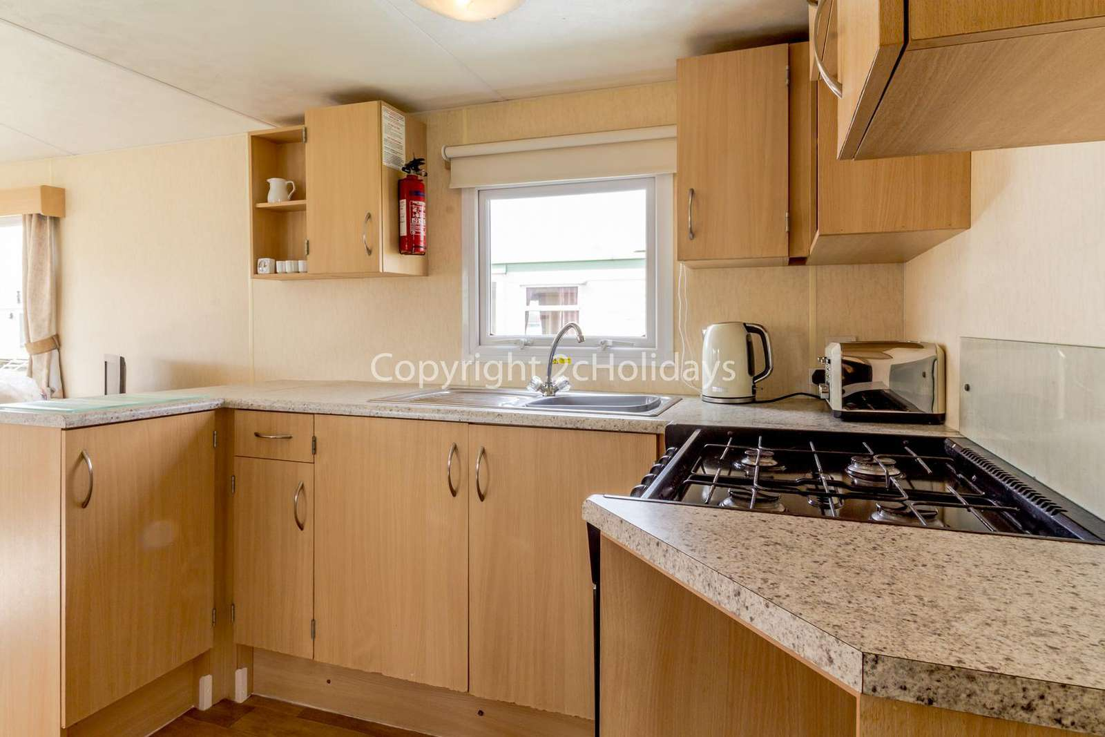 This spacious kitchen includes a full size cooker and fridge/freezer!
