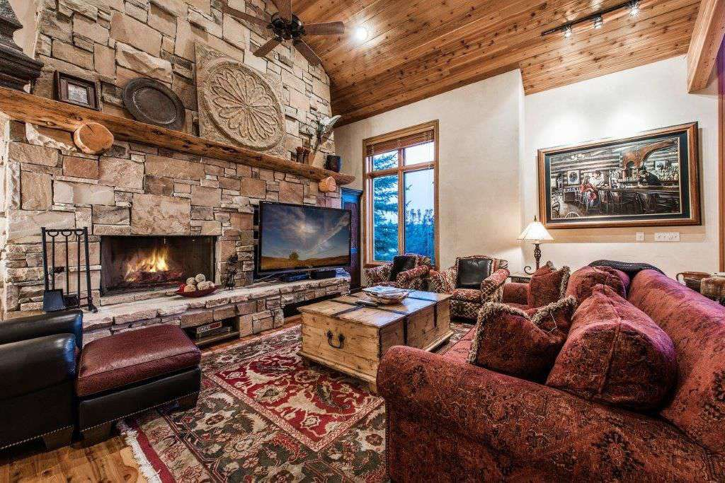 main living room with massive stone fireplace