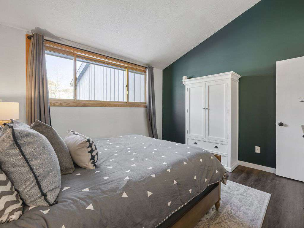 Guest bedroom on the second floor with large windows