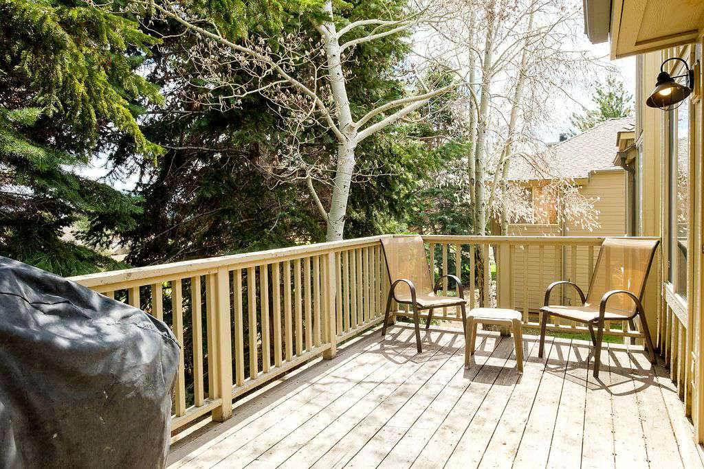 Side view of private deck with lawn chairs