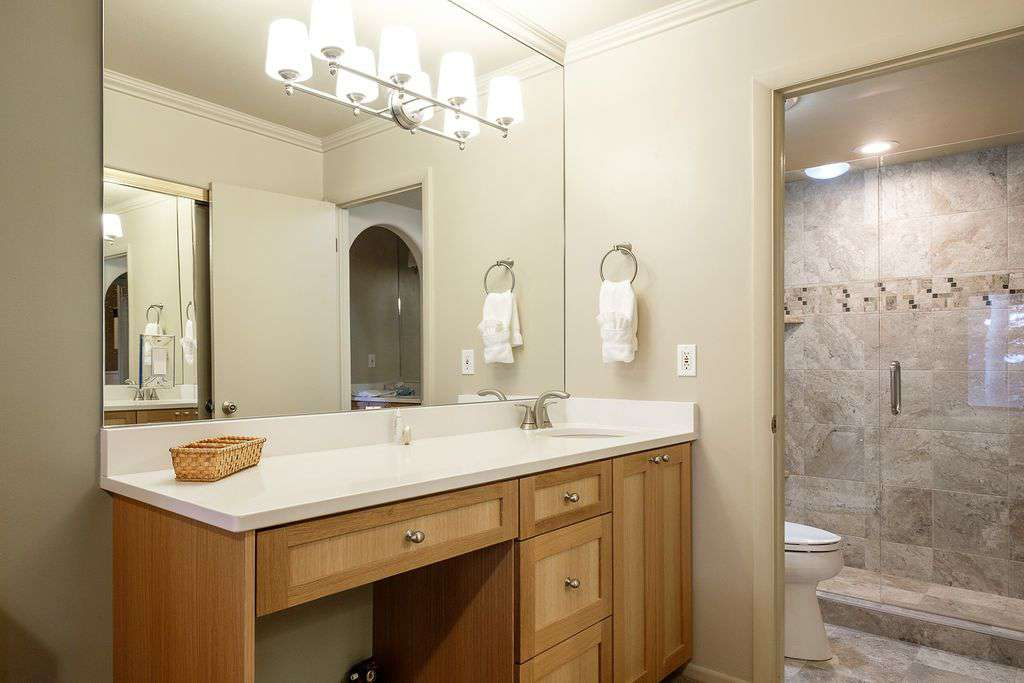 First floor master bedroom vanity and private bathroom entrance