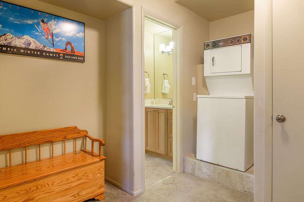 First floor bathroom communal entrance with washer and dryer