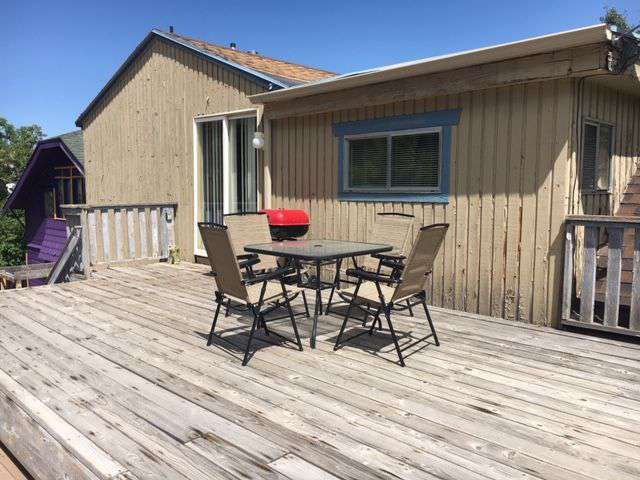 Deck with barbecue and furniture