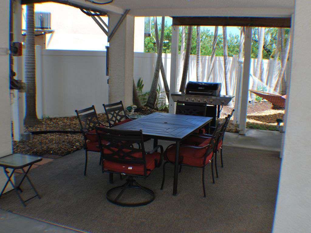 out door patio area with Gas Grill and Patio table. Also a Hammock for relaxing